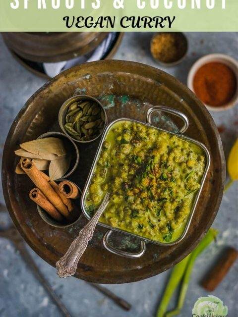 Moong Sprouts Coconut Vegan Curry in a square bowl with a spoon inside placed on a plate with whole spices on the side and text at the top