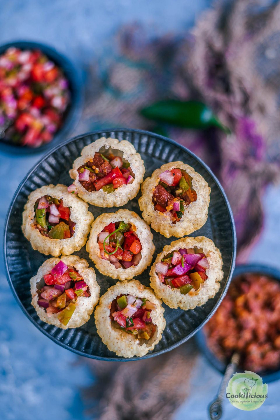close up shot of Indian Mexican Pani Puri arranged in a round plate