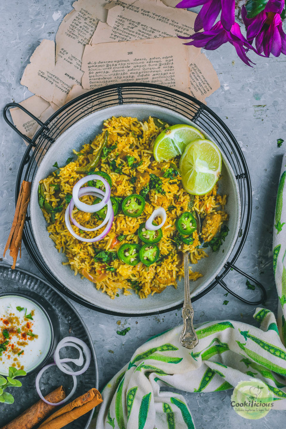 Soya Chunks Pulao in a round bowl garnished with sliced jalapeno and lemon wedges
