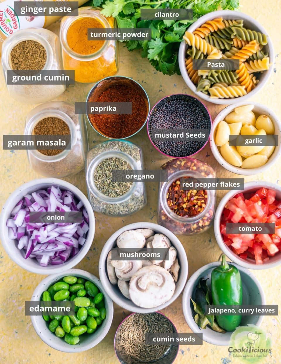 all the ingredients needed to make Indian Pasta Recipe | One-Pot Vegan Curry Pasta Dish placed in a tray with labels on them