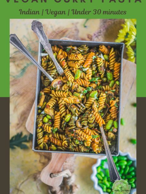 a rectangular serving platter filled with Indian Pasta Recipe | One-Pot Vegan Curry Pasta Dish and three spoons in it and text at the top