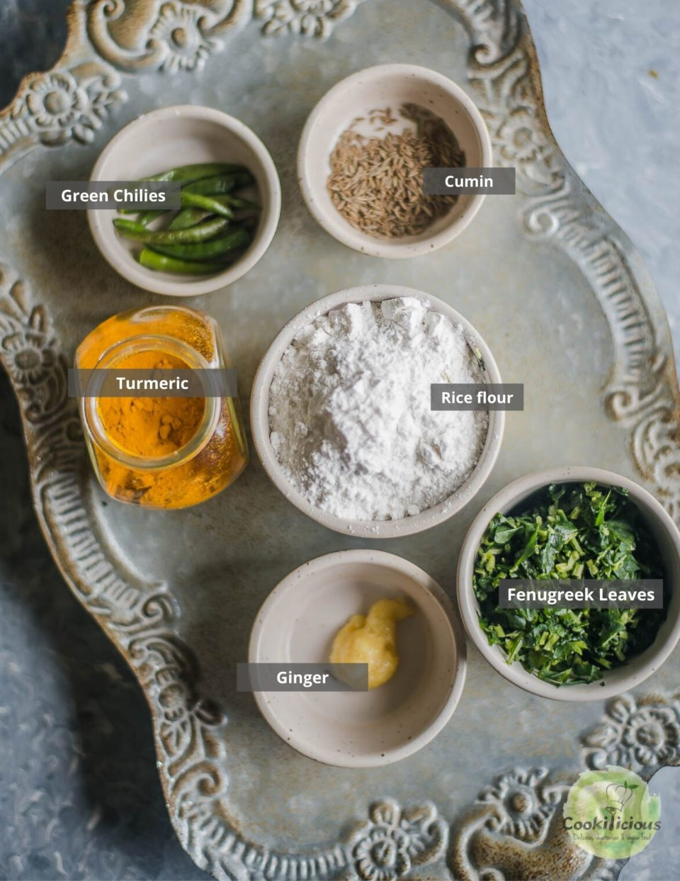 all the ingredients needed to make Methi Ghavan | Fenugreek Rice Flour Crepes placed in a tray with labels on them