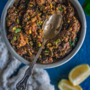 a spoon resting over a bowl of Moroccan Eggplant Zaalouk