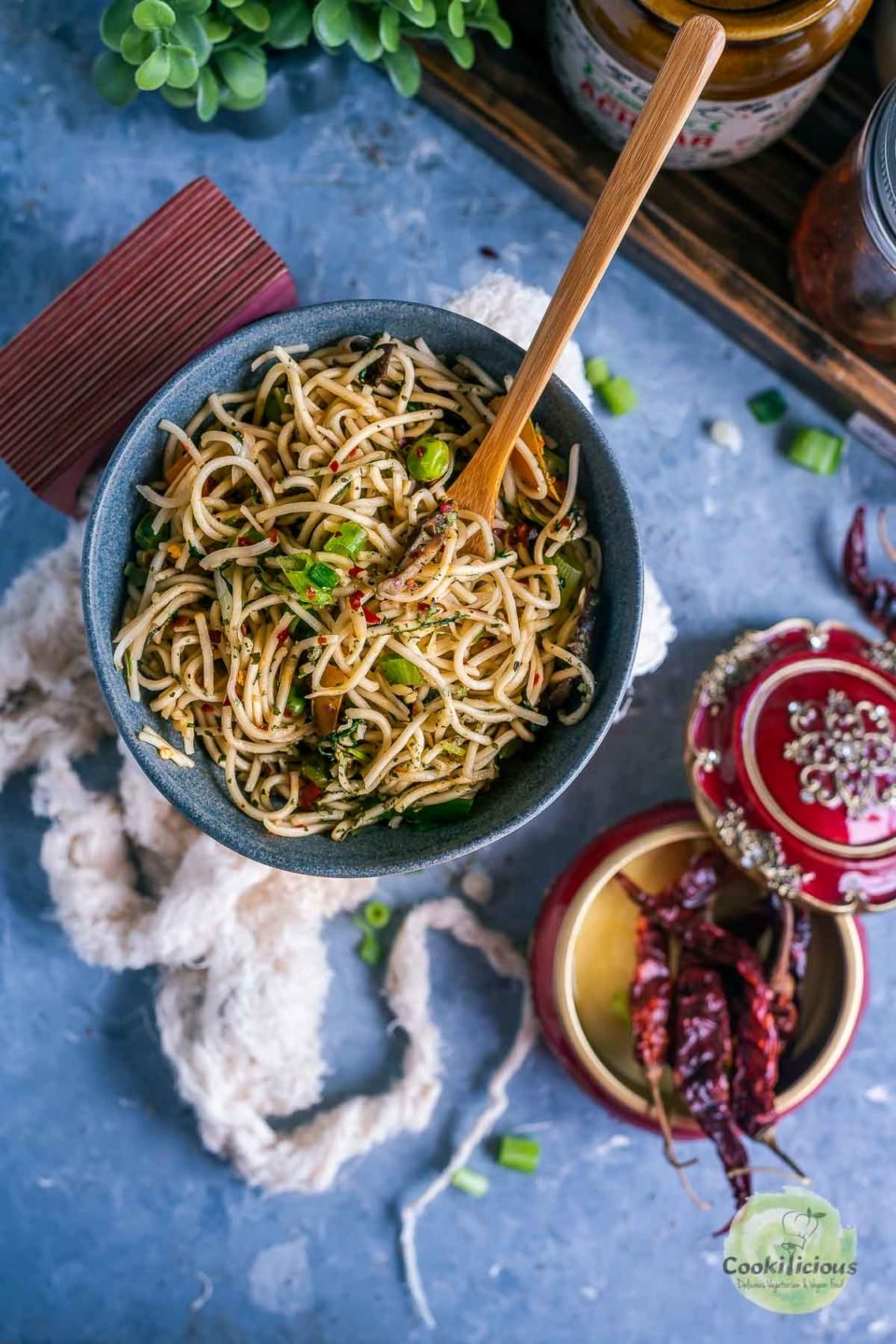 Hot and Spicy Noodles/ Cilantro Pot Noodles in a small round bowl with a fork in it