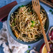a bowl of Hot and Spicy Noodles/ Cilantro Pot Noodles with a fork resting on top