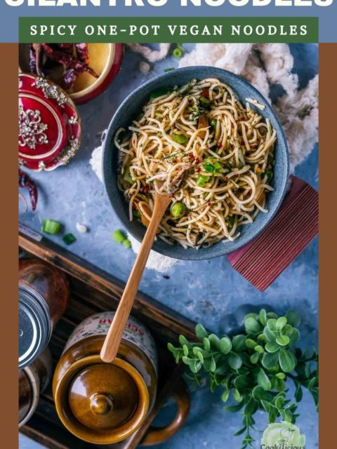 Hot and Spicy Noodles/ Cilantro Pot Noodles in a bowl with a fork in it and a jar on the side and text at the top