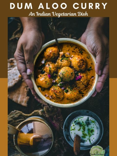 a set of hands holding a bowl of Dum Aloo and text at the top