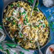 a platter of Potato Rice With Mint | Instant Pot Aloo Pudina Pulao with 2 spoons in it