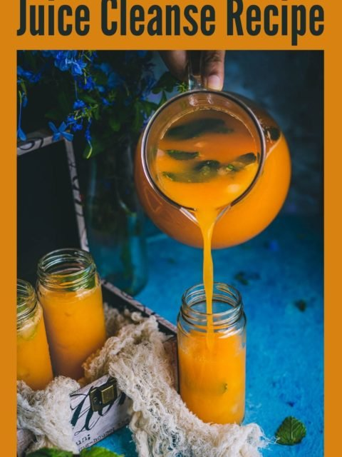Organic Energy Drink With Carrots, Orange and Cantaloupe being poured from a jug into a glass and text at the top