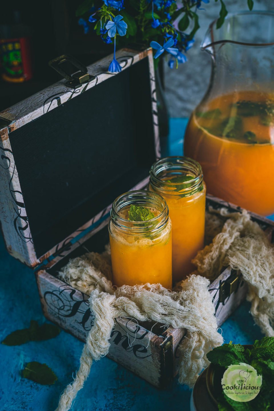 2 glasses of Organic Energy Drink With Carrots, Orange and Cantaloupe placed in a box
