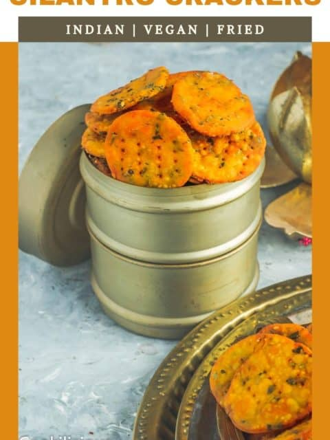 popular Indian snacks like mathri served in a lunchbox and text at the top