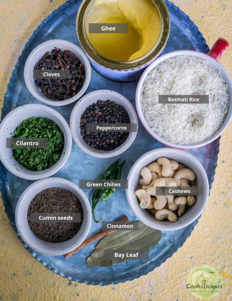 all the ingredients needed to make jeera rice in the Instant pot placed in a tray with labels on them