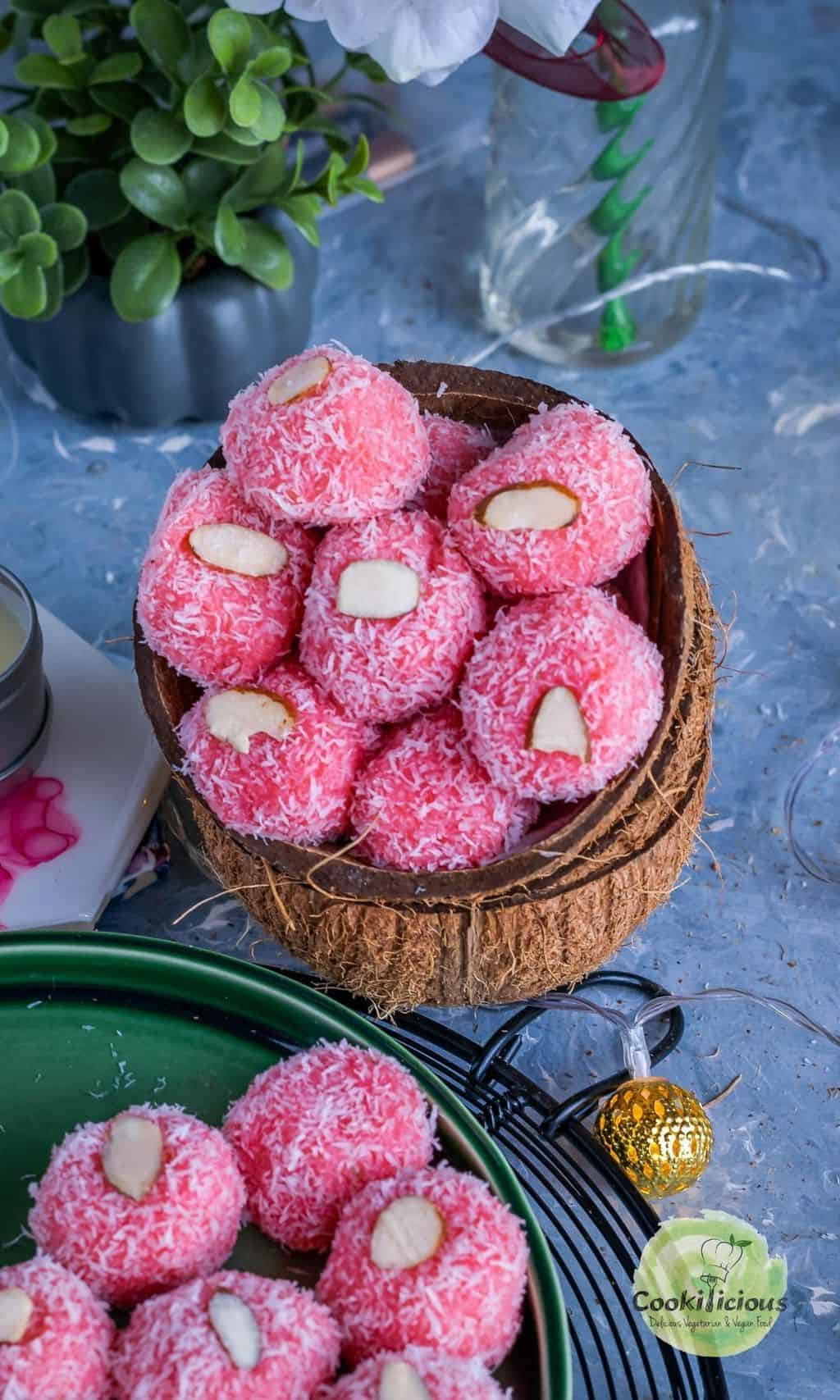 rose coconut ladoos served in coconut shells