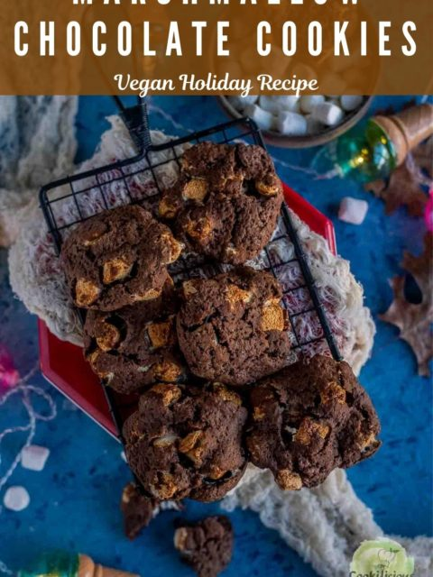 Vegan Marshmallow Chocolate Cookies placed over a wire rack with festive decor around it and text at the top