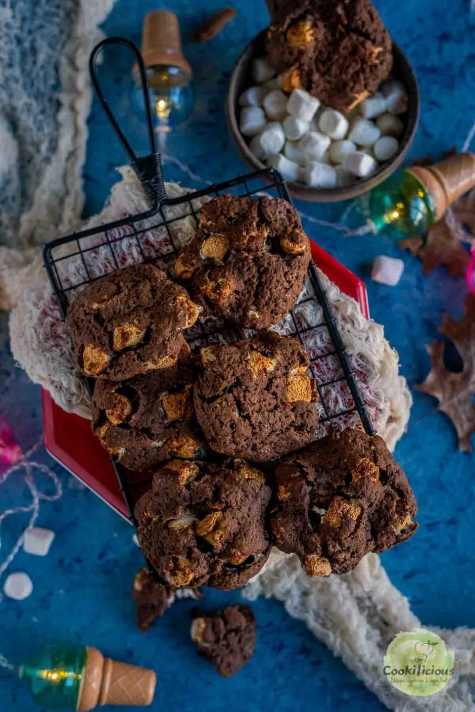 Vegan Marshmallow Chocolate Cookies placed over a wire rack with festive decor around it