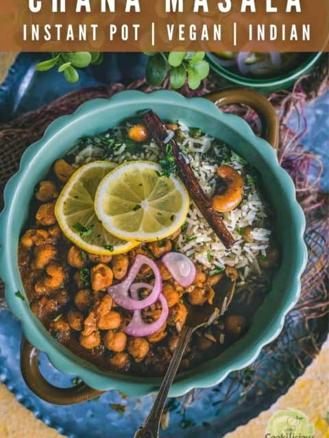 a round bowl filled with Vegan Chana Masala with a spoon in it and text at the top