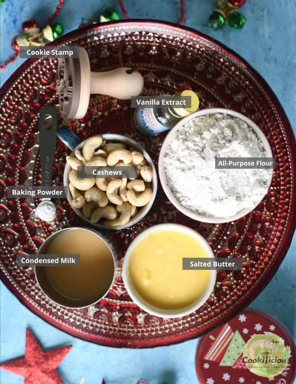 all the ingredients needed to make Nankhatai arranged on a tray with labels on them