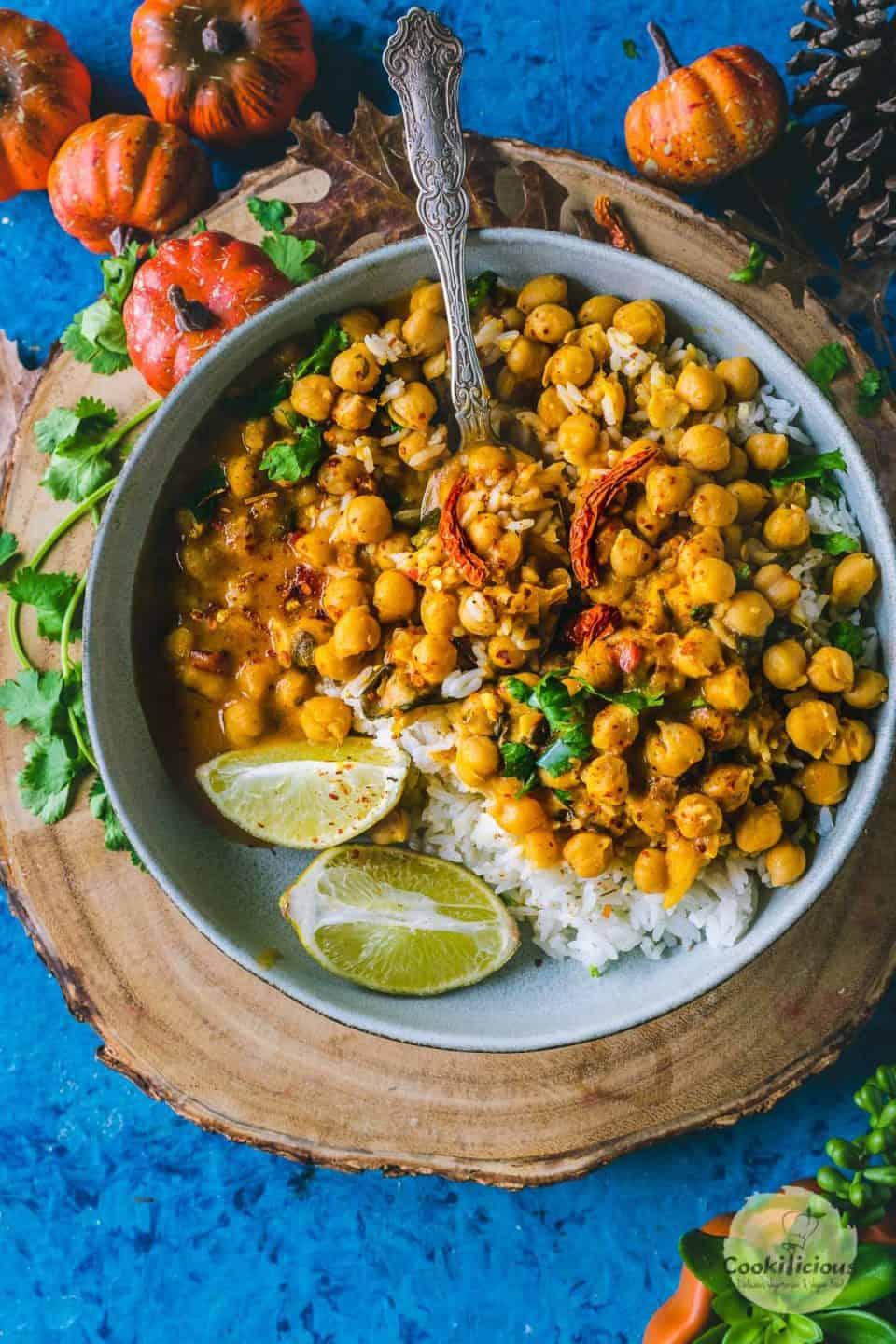 a round bowl filled with Instant Pot Butternut Squash Chickpea vegan Thai Curry