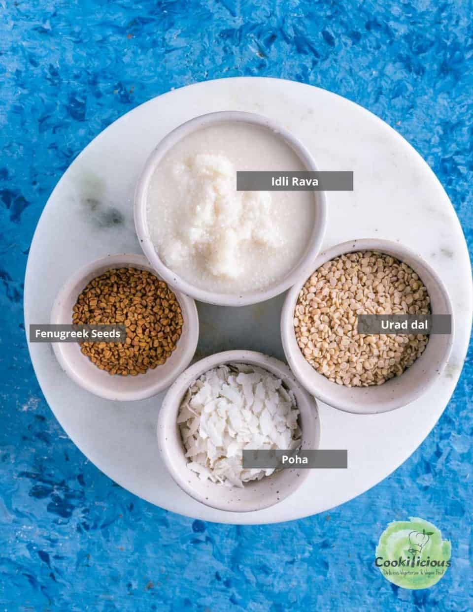 all the ingredients needed to make idli batter placed on a tray with labels on them