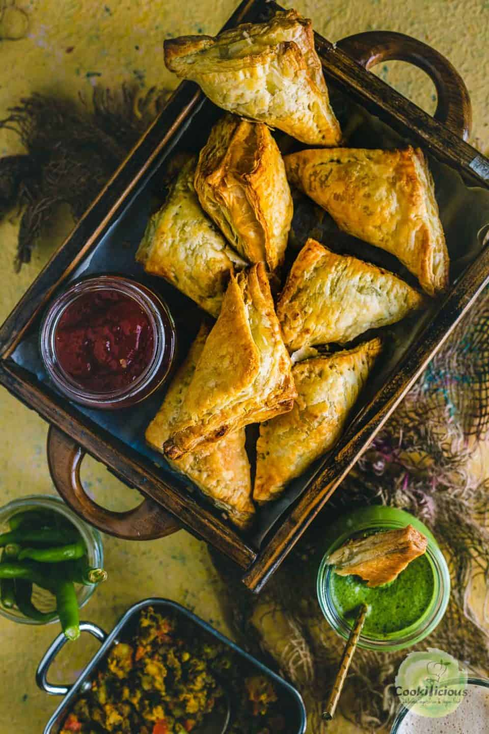 Vegetable Puff Pastry Samosa served in a wooden tray