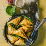 Vegetable Puff Pastry Samosa served with ketchup, chutney and chai.