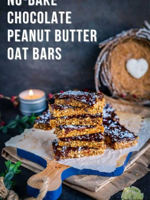 Peanut Butter Chocolate Oats Bars stacked one on top of the other with text on the top left