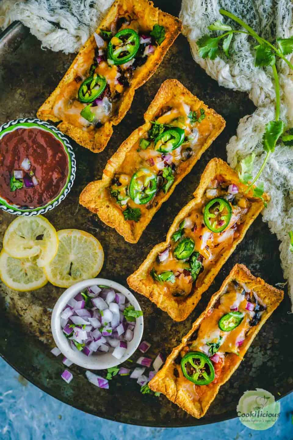 4 Instant Pot Black Beans Taco Boats served in a platter