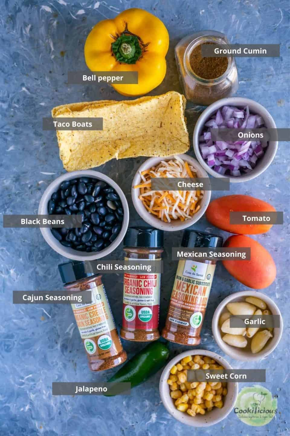 all the ingredients needed to make Instant Pot Black Beans Taco Boats placed on a table with labels on them