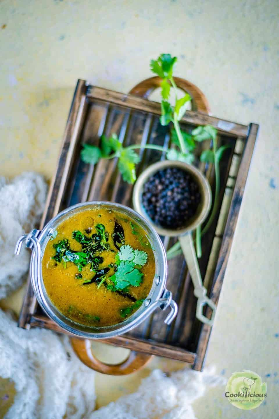 Jeera Milagu Rasam served in a wooden tray