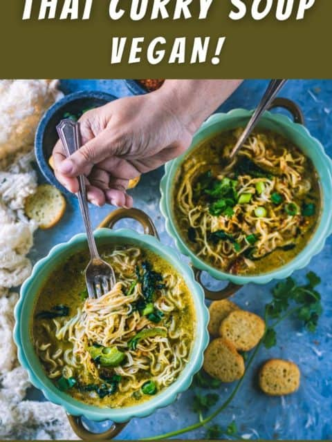 a hand digging into a bowl of Vegan Thai Curry Noodles Soup with a spoon and text at the top