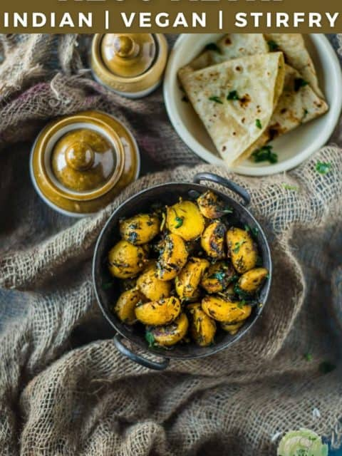 Aloo Methi served with chapati and pickle jars on the side and text at the top
