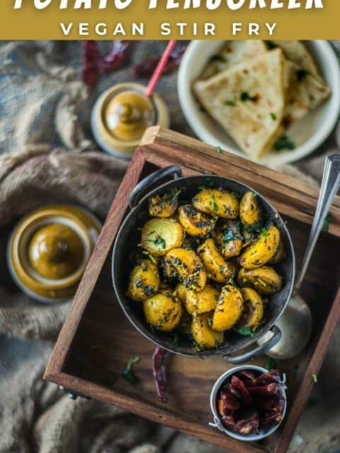 Aloo Methi served in a kadai and placed on a wooden tray and text at the top and bottom