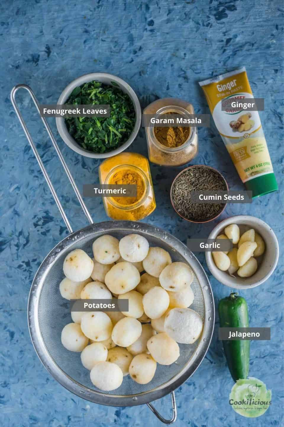 all the ingredients needed to make Aloo Methi placed on a table with labels on them