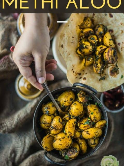 a hand digging into a bowl of Aloo Methi using a spoon and text at the top