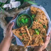 a set of hands holding a platter filled with Tandoori Cheese Quesadilla