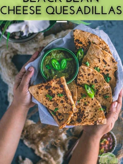 a set of hands holding a platter filled with Tandoori Cheese Quesadilla and text at the top