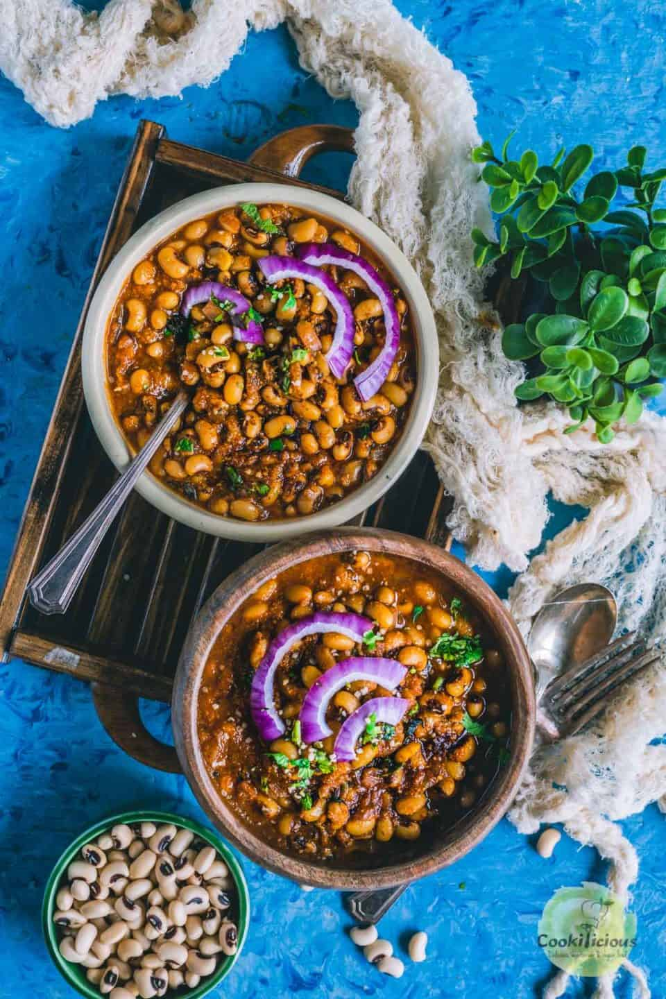 2 bowls filled with Chettinad Black Eyed Peas Curry