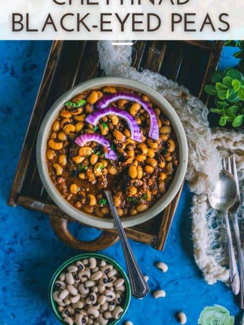 Chettinad Black Eyed Peas Curry served in a round bowl with a spoon in it and text at the top