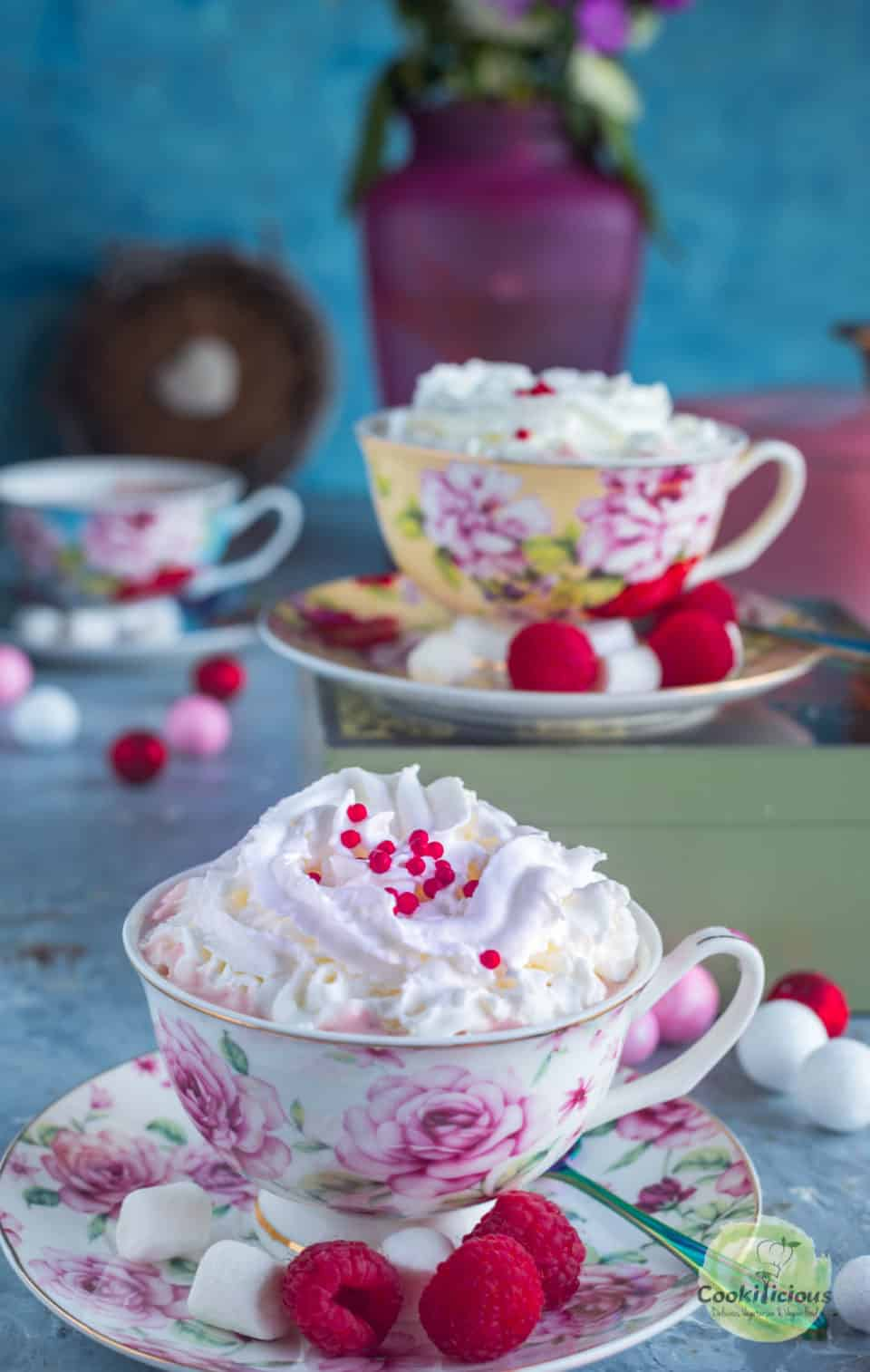 Vegan Raspberry Rose Hot Chocolate served in teacups with whipped cream on top