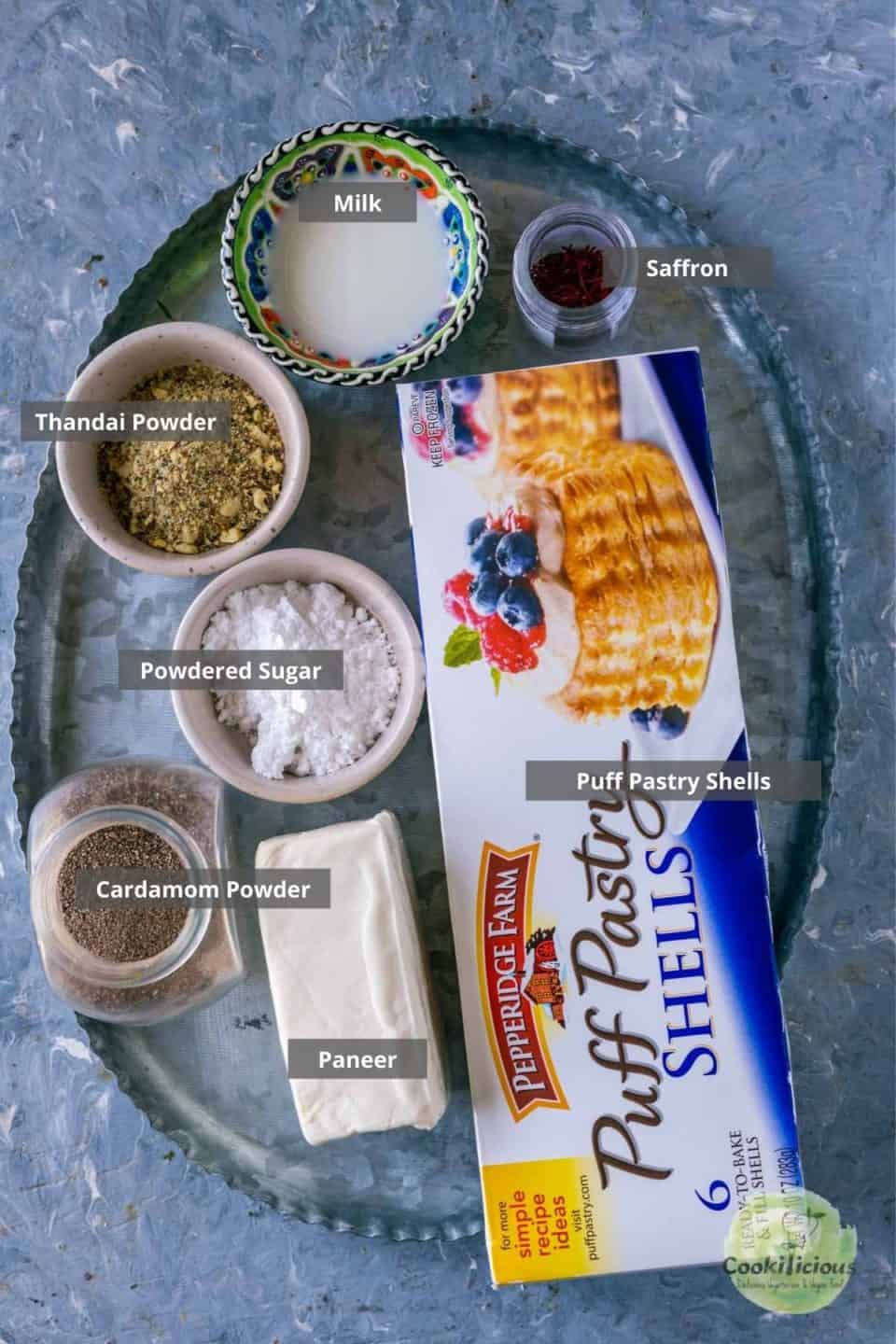 all the ingredients needed to make paneer gujia placed on a platter with labels on them