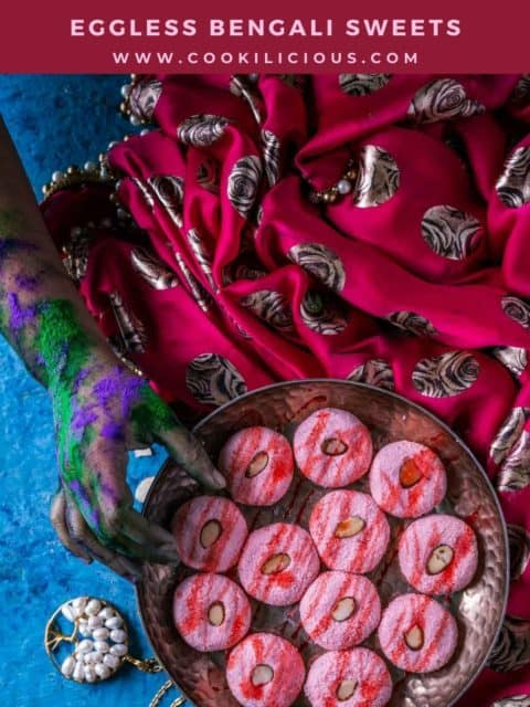 one colored hand reaching out to pick one Rose Sandesh - Bengali Sweet from a tray and text at the top