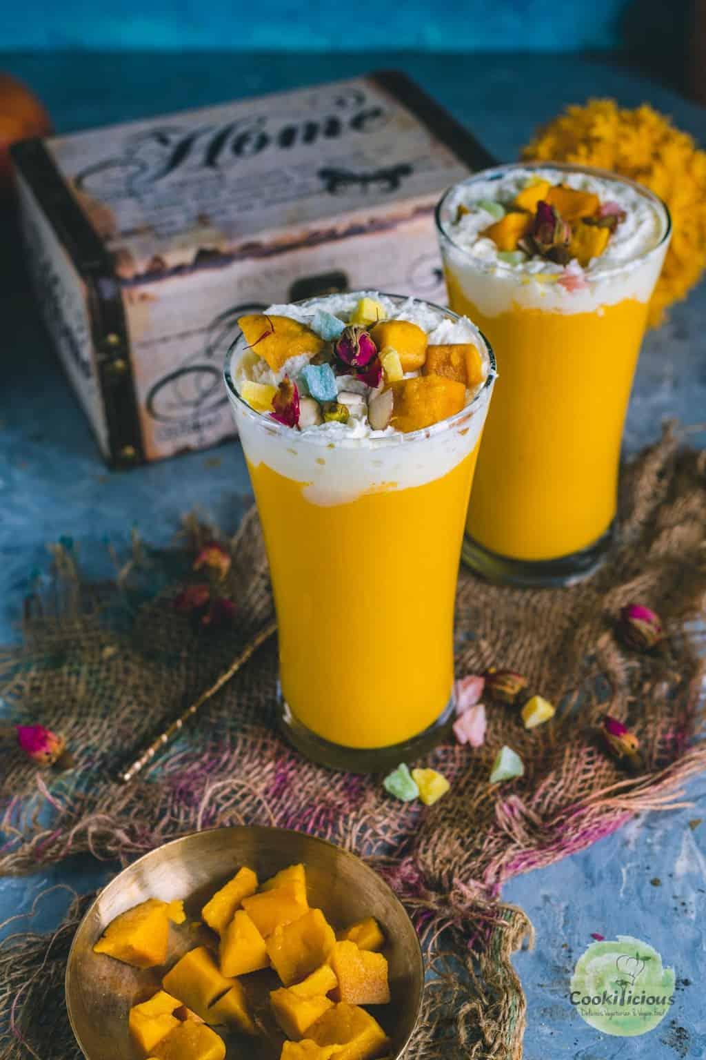 2 glasses filled with Mango Mastani
