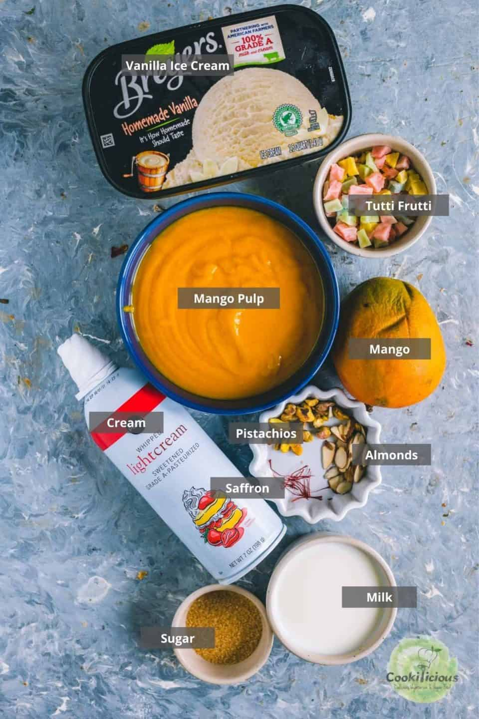 all the ingredients needed to make mango mastani placed on a table with labels on them