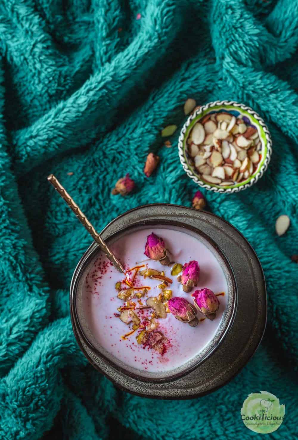 a bowl of Vegan Rose Basundi with a spoon in it