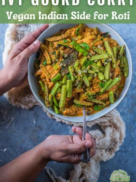 one hand holding the bowl while the other hand digging into a bowl of Shahi Tendli with a spoon and text at the top