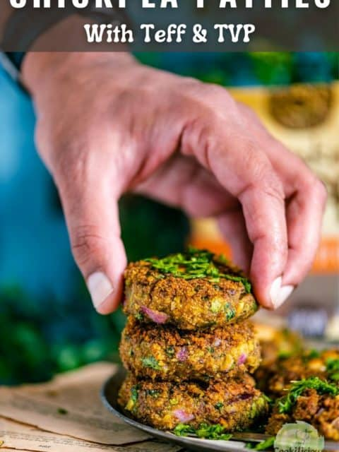 a hand picking up one chickpea patty from a stack and text at the top
