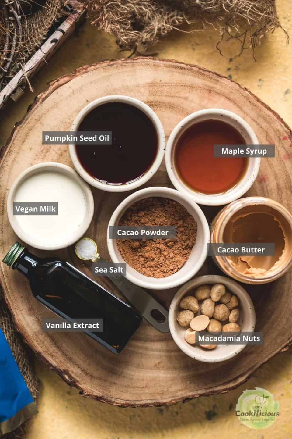 all the ingredients needed to make Vegan Chocolate Macadamia Bars Recipeplaced on a tray with labels on them