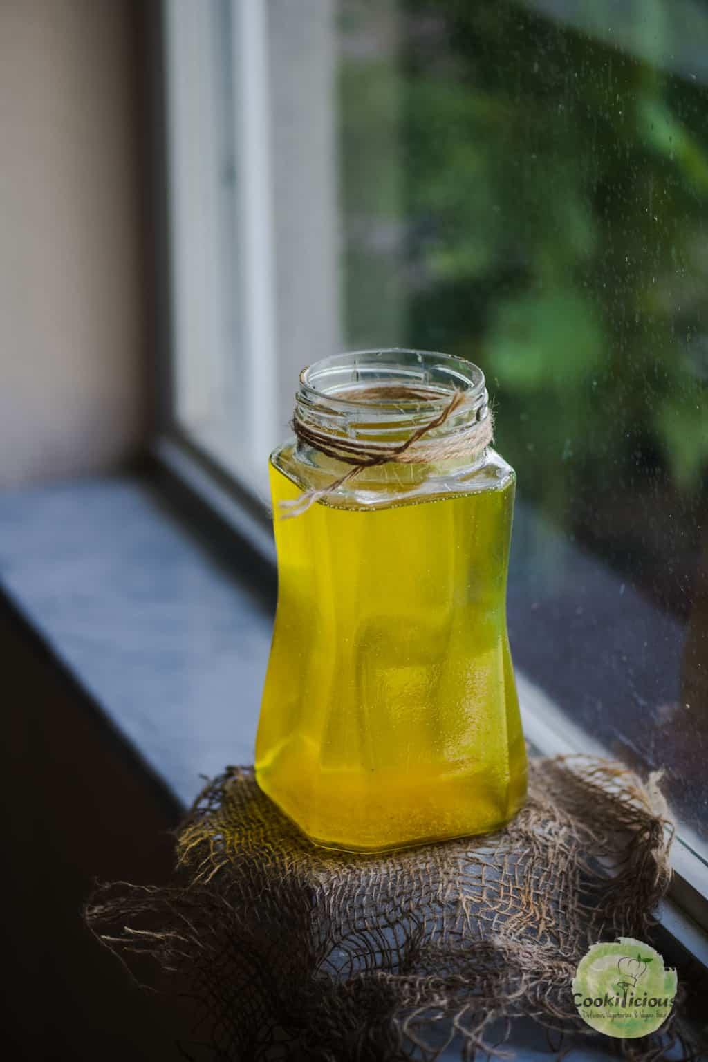 Vegan ghee in a jar placed on the window sill.