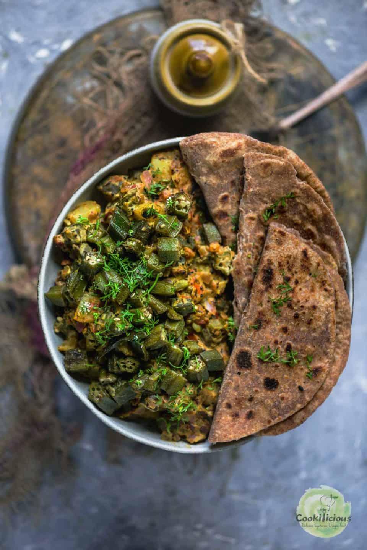 roti and Achari Dahi Bhindi served in a plate