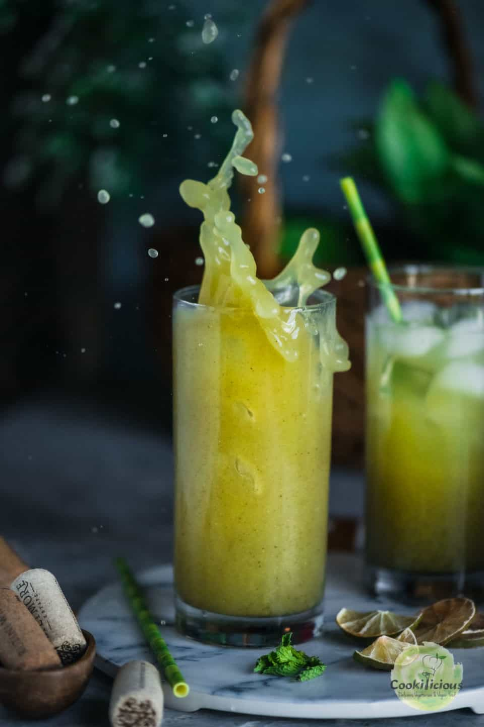 Cucumber Lemonade served in a glass with a splash